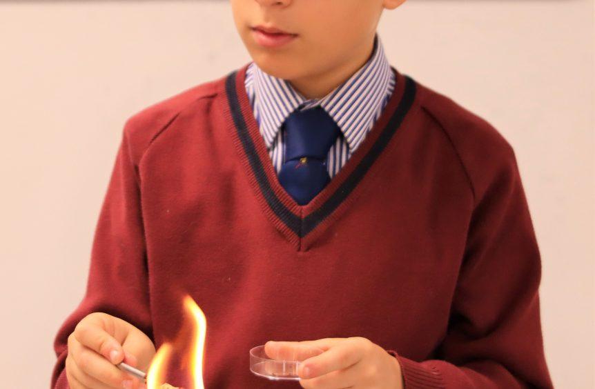 schoolboy using a bunsen burner