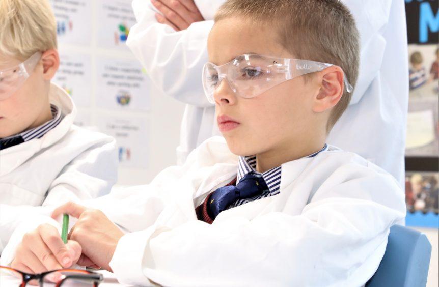 schoolboy in science lesson