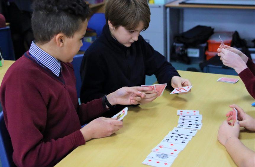 school boys playing cards