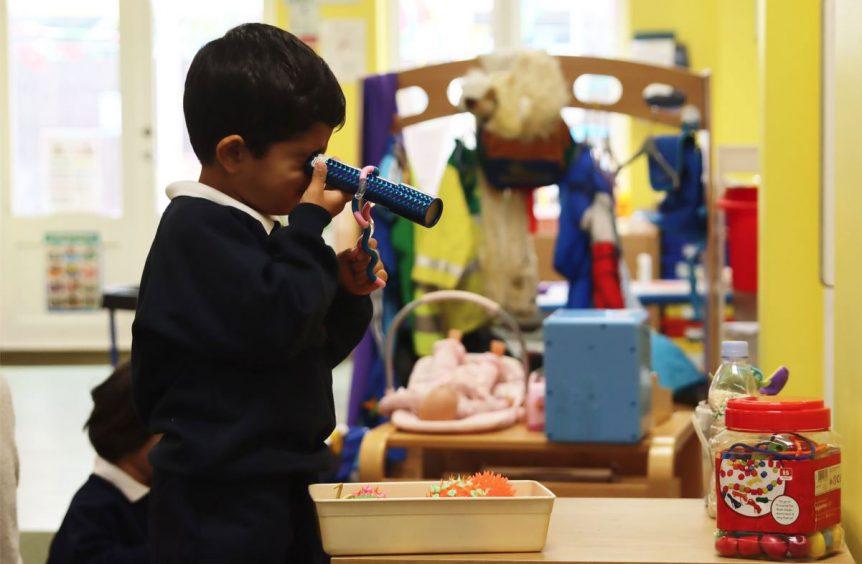 A boy using a kaleidoscope