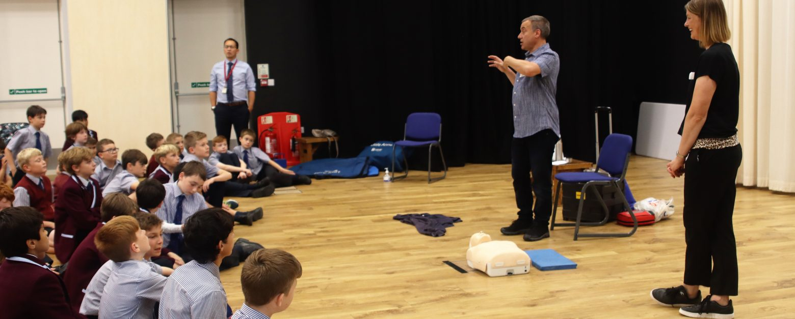 The first aid teacher talks to the class as he speaks about CPR and safety
