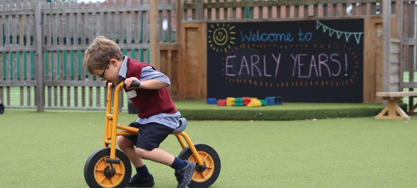 A boy pushing a bike