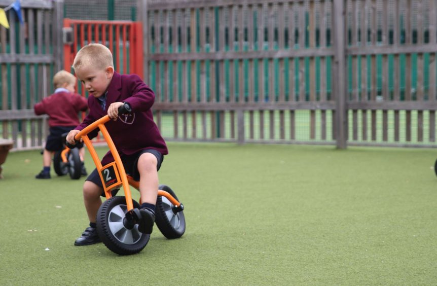 A boy practicing on a small bike